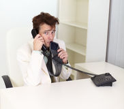 Disheveled businessman talking on phone Royalty Free Stock Photography