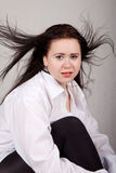 Disheveled long-haired woman in a white men's shirt Stock Photo