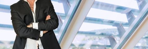 Disheveled man in business suit with folded hands Stock Photo