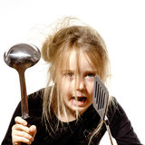 Disheveled preschooler girl with soup ladle Royalty Free Stock Photography