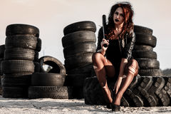 Disheveled redhead woman with a baseball bat Royalty Free Stock Images