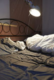 Disheveled sheets and pillows of an unmade bed Stock Photography