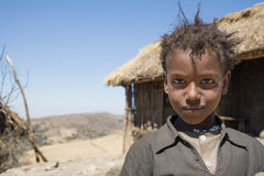 Disheveled young girl posing for a picture, Bale Mountains, Ethi Stock Image