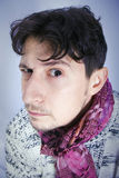 Dishevelled young man with scarf Royalty Free Stock Image