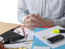 Dishevilled busy man at chaotic desk - overwork Royalty Free Stock Image