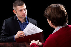 Dishonest insurance agent. Wanting to deceive his new client Royalty Free Stock Photo