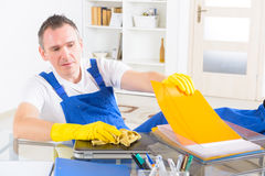 Dishonest man cleaner at the office Stock Photography