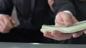 Dishonest realtor taking money for house, giving keys to client, financial fraud. Stock footage stock footage