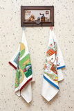 Dishtowels hung on wooden hatrack Royalty Free Stock Images