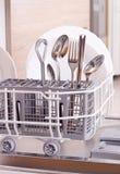 Dishware in afwasmachine Stock Foto's