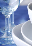 Dishware on the blue tablecloth Royalty Free Stock Image