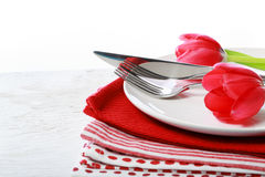 Dishware with red tulips Royalty Free Stock Photo