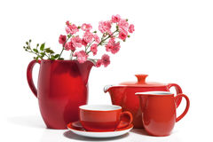Dishware. Summer Red Dishware with Pink Roses, isolated on white royalty free stock photos