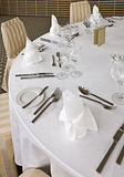 Dishware on a table. Knife, fork, spoon, plate and glases on a table Stock Photos
