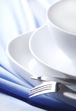 Dishware on the tablecloth. Dishware on the blue tablecloth Stock Images