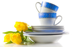 Dishware and tulips Stock Photography