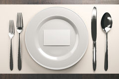 Dishware with white card. Top view of dishware with empty white business card. Mock up, 3D Rendering Stock Photography