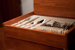 Dishware in wooden box Royalty Free Stock Image