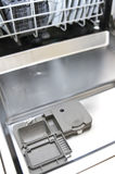Dishwasher. Inside of a dishwasher with detergent compartment open Royalty Free Stock Photography