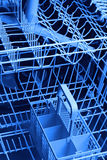 Dishwasher. Close up of dishwasher blue background Royalty Free Stock Photography