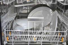 Dishwasher. With some white plates and glasses Royalty Free Stock Photography