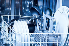 Dishwasher. Clean dinnerware inside a dishwasher Royalty Free Stock Images