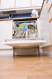 Dishwasher. Opened dishwasher with clean dishes Royalty Free Stock Photo
