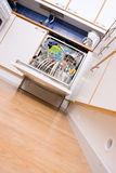 Dishwasher. Opened dishwasher with clean dishes Stock Photo