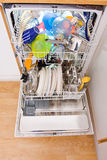 Dishwasher. Opened dishwasher with clean dishes Royalty Free Stock Photos