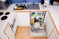 Dishwasher. Opened dishwasher with clean dishes Stock Photos