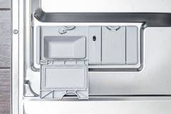 Dishwasher as the efficient use of resources for domestic and everyday activities stock photo