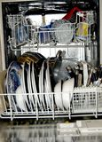 Dishwasher clean portrait. A portrait layout image of dishwasher with clean dishes Royalty Free Stock Photos