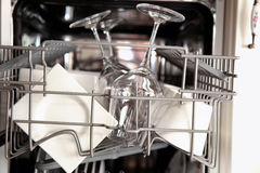 Dishwasher with clean utensils Stock Photography
