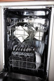 Dishwasher with clean utensils Stock Photo
