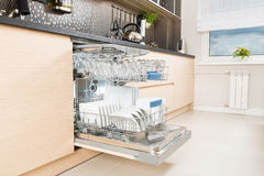 Dishwasher after cleaning process. Royalty Free Stock Image