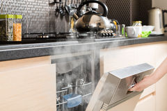 Dishwasher after cleaning process. Royalty Free Stock Photos