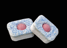 Dishwasher detergent tablets macro isolated Royalty Free Stock Images