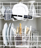 Dishwasher and Dirty Dishes. Dishes in a dish washer Stock Photo