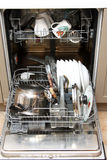 Dishwasher with dirty dishes Royalty Free Stock Photos