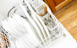 Dishwasher filled with Dinner Plates and silverware Stock Photos