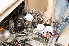 Dishwasher full of dishes Stock Photos