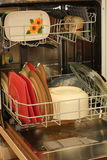 Dishwasher full of dishes Royalty Free Stock Image