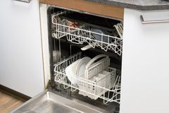 Dishwasher in kitchen Royalty Free Stock Image