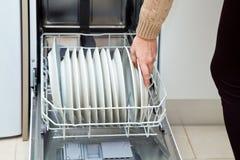 Dishwasher at the kitchen Stock Photos
