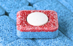 Dishwasher soap. Tablet all in one royalty free stock image