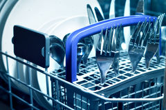 Dishwasher with steel cutlery Stock Photography