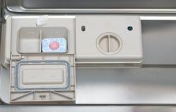 Dishwasher tablet in dispenser Stock Image