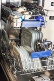 Dishwasher with white plates Stock Image