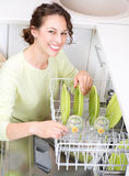 Dishwasher. Young woman doing Housework royalty free stock photography