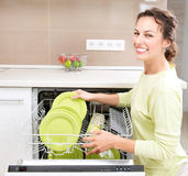 Dishwasher. Young woman doing Housework stock photography